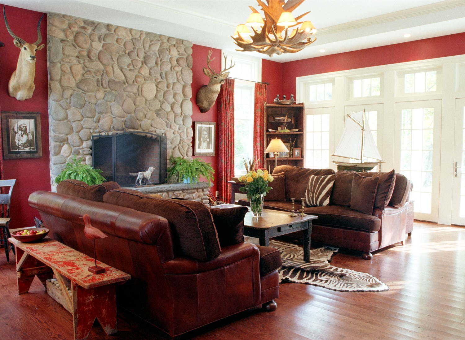 Old-country-style-luxury-living-room-with-stone-fireplace-leather-sofas